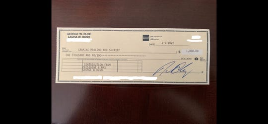 Lee County Sheriff Carmine Marceno recently received a $1,000 campaign donation check from former president and Mrs. George Bush.