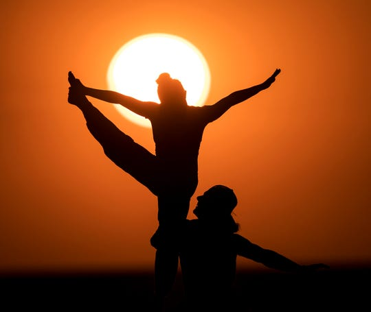 Lake Sandusky and her boyfriend, Michael Johnston make a selfie video during sunset on Fort Myers Beach on Sunday Feb. 9, 2020.