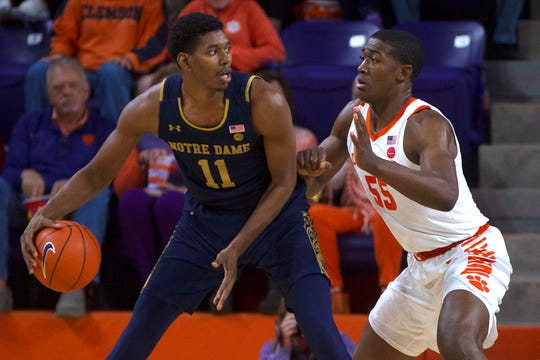 Notre Dame Fighting Irish forward Juwan Durham (11) attempts to drive to the basket while being defended by Clemson Tigers center Trey Jemison Sunday in Clemson.