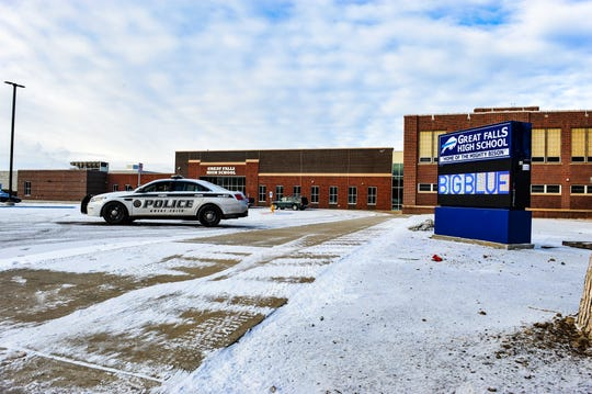 A Great Falls Police cruiser sits in the parking lot of Great Falls High School on Monday morning after a bomb threat lead officials to close all schools in Great Falls on Monday.