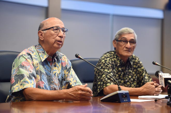 Consolidated Commission on Utilities Chairman Joey Duenas, left, and Guam Power Authority General Manager John M. Benavente discuss the timetable for complying with a consent decree during a news conference in Mangilao Monday.