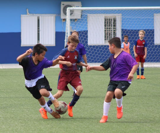 Barrigada Crusaders and Bank of Guam Strykers FC play in an opening day U12 division match of the Triple J Auto Group Robbie Webber Youth Soccer League Saturday at the Guam Football Association National Training Center. League play continues with Week 2 matches Feb. 15 at GFA.