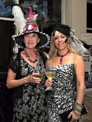 2013: The Mardi Gras theme was Hat's Off. Participants (from left)  French Honorary Consul Joelle Wainer, Guam Women's Club Past President Celine San Nicolas.