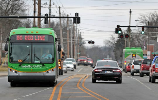 Buses travel in traffic on the south side of the Red Line, Friday, Jan. 31, 2020.