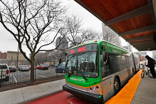 A Red Line bus picks up riders at the stop on Capitol Avenue at Vermont Street, Friday, Jan. 31, 2020. While there's no firm data about who exactly is riding the Red Line, IndyGo said anecdotal information shows the riders are a very diverse group.