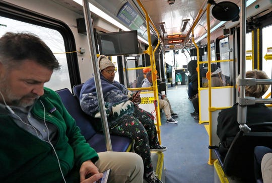 Riders ride on the Red Line, Friday, Jan. 31, 2020.