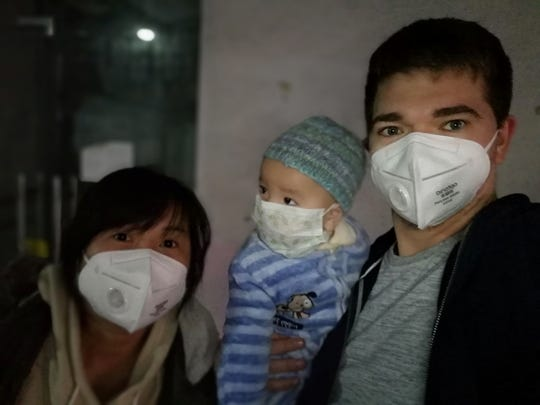 IU graduate Zack Stant, son Thomas, and wife Cindy wear masks whenever they leave their home in China.