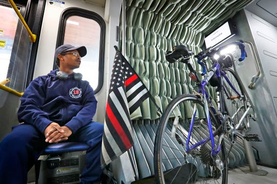 Keontai Ferrell waits for his ride on the Red Line, Friday, Jan. 31, 2020.