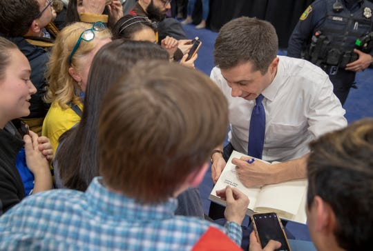 Pete Buttigieg greets well-wishers and signs autographs at Salem High School, Salem, N.H., Monday, Feb. 9, 2020. The stop is one of numerous ones that Buttigieg and other democrats vying for the party's nomination for president are making in this New England state before Tuesday's primaries.