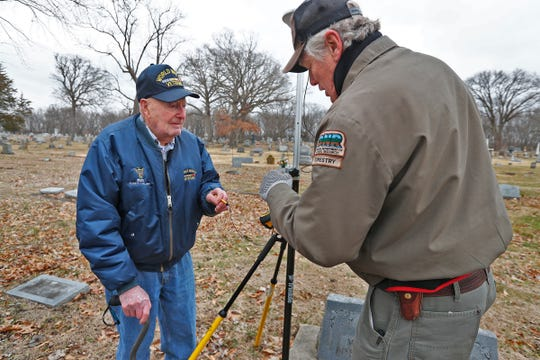 Bob Vollmer, 102, left, works with Frank Ballintyn surveying in the Riverside Cemetery in Clinton, IN, Wednesday, Feb. 5, 2020.  It was Vollmer's last day at work after working for the Department of Natural Resources for 57 years.  He is the state's oldest employee and retires Feb. 6, 2020.