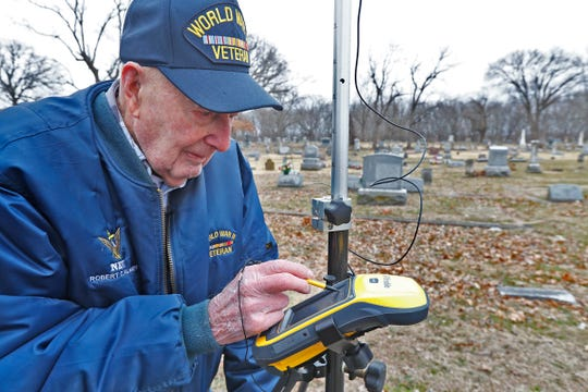 Bob Vollmer, 102, checks a GPS reading as he surveys in the Riverside Cemetery in Clinton, IN, Wednesday, Feb. 5, 2020.  It was his last day at work before retiring after working for the Department of Natural Resources for 57 years.  He is the state's oldest employee and retires Feb. 6, 2020.