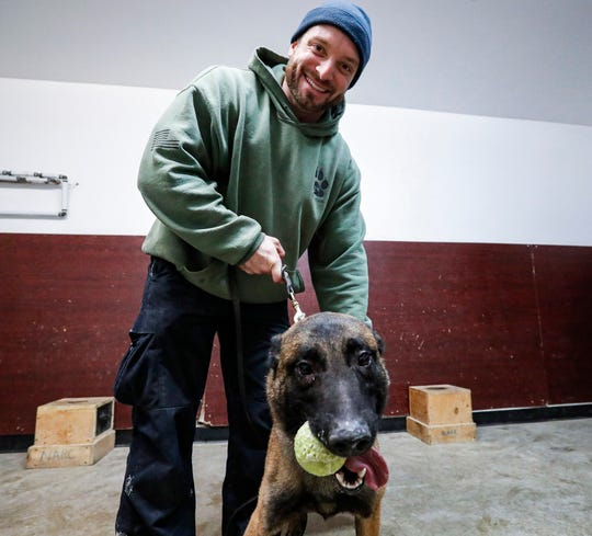 Fishers K-9 Patrol Officer Jarred Koopman, left, helps train Rico with Luis Rodriguez, right, at Vohne Lichee Kennels, Denver, Ind., Tuesday, Feb. 4, 2020. A few months after Harlej, the Fishers Police Department K-9 officer was shot on duty, Koopman takes two weeks at Vohne Lichee Kennels to pick out a new K-9 partner.