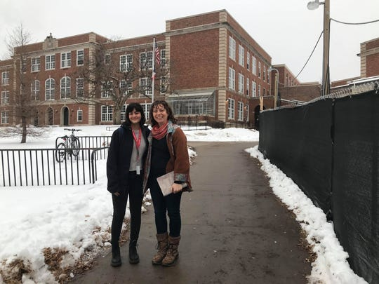 Green Iowa consultants Adriana Morales (left) and Lisa Stark pose outside City High.