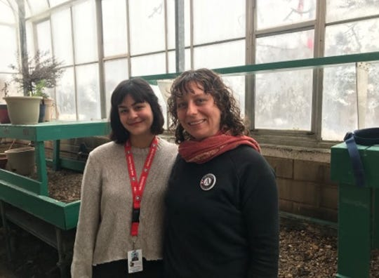 Green Iowa consultants Adriana Morales (left) and Lisa Stark pose in City High's greenhouse. The two hope to revive the greenhouse and several other conservation projects across the district.