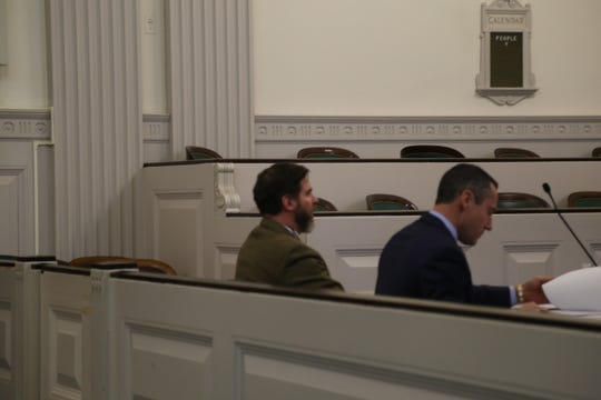 David Hall (left) sits during a proceeding at the Tompkins County Corthouse.
