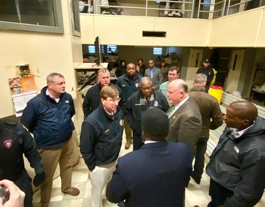 Gov. Tate Reeves, center, and other officials tour Mississippi State Penitentiary at Parchman after weeks of violence and deaths in Mississippi's prison system.
