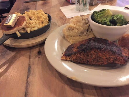 Puckett's Whiskey Platter with grilled salmon, blackened and brushed with Tennessee whiskey glaze and served with mashed potatoes and steamed broccoli.