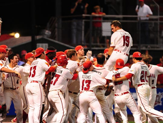Second baseman Jace Conrad is lifted by a pack of Ragin' Cajuns after homering to beat Florida International 9-6 in the 2014 Sun Belt Conference Tournament title game.