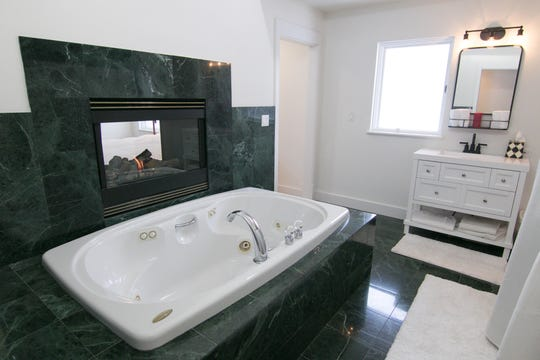 A gas fireplace faces both the ensuite bath and the master bedroom of the Bennett home, shown Monday, Feb. 10, 2020.