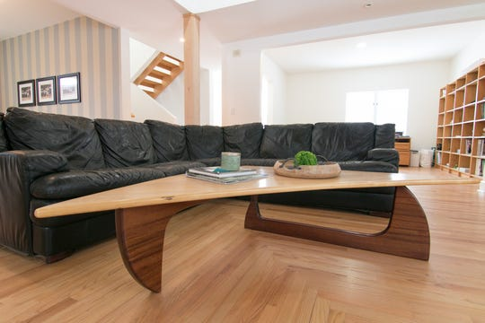 A coffee table in the living room of the Bennett home, shown Monday, Feb. 10, 2020, exemplifies the homeowner's woodworking artisanship.
