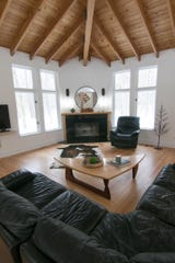 The living room of the Bennett home, shown Monday, Feb. 10, 2020, showcases the homeowner's skill and passion for woodworking.