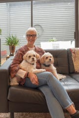 Laura Edwards and her canine companions in her East Memphis condominium designed by architect Francis Mah.