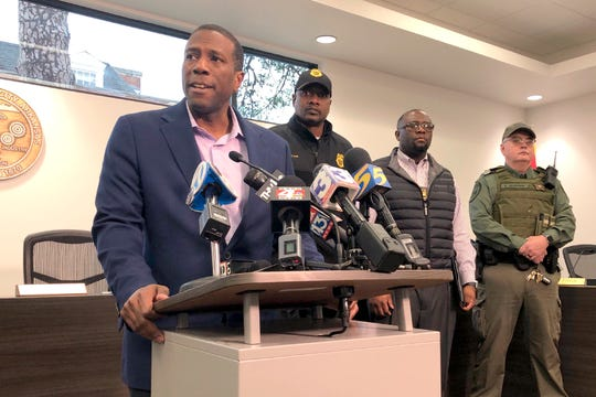 Forrest City Mayor Cedric Williams, left, holds a news conference after two police officers were wounded and a gunman was killed in an exchange of gunfire at a Walmart store in eastern Arkansas Monday morning.