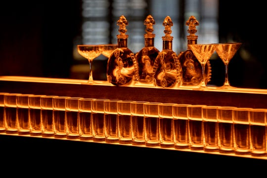 Glasses and decanters sit on the back bar Monday, Feb. 10, 2020, at Porch & Parlor in Overton Square.