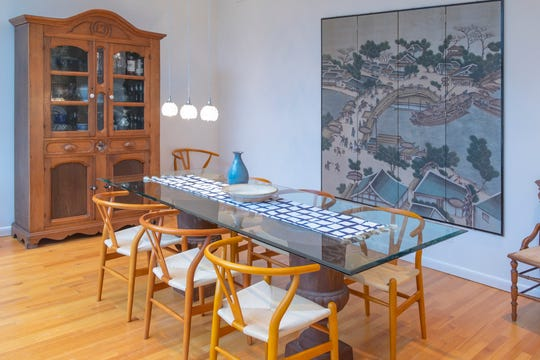 The light-filled, spacious dining room showcases Laura Edwards' love of art.