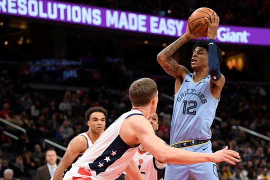 Memphis Grizzlies guard Ja Morant (12) goes to the basket next to Washington Wizards forward Moritz Wagner, left, during the first half of an NBA basketball game, Sunday, Feb. 9, 2020, in Washington.
