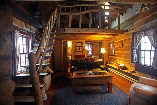 The Cothren House cabin has a bathroom, kitchen and living area on the first floor and a queen bed in a lofted bedroom.