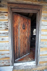 The door to the Cothren House cabin is not original to the 1830s home, but it was built with the time period in mind, including with an antique lock and key.