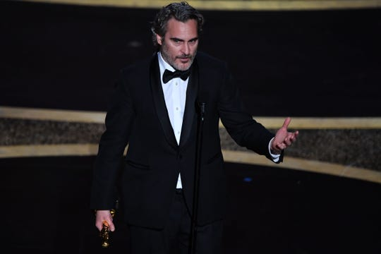 "Joaquin Phoenix accepts the award for Best Actor in a Leading Role for ""Joker"" on Sunday during the 92nd Oscars at the Dolby Theatre in Hollywood. Phoenix spoke about dairy farms' treatment of cows during his speech."