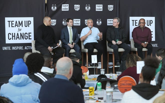 """The """"Team Up for Change"""" summit at Fiserv Forum in February 2020 closed with a panel discussion featuring speakers, from left, Marc J. Spears, senior NBA writer for The Undefeated; Alex Lasry, Milwaukee Bucks senior vice president; Marc Lasry, co-owner of the Milwaukee Bucks; Paul E. Jacobs, vice chairman of the Sacramento Kings; and Chet P. Hewitt, president and CEO of Sierra Health Foundation."""