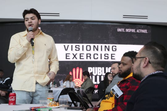 """Ruben Gaona Jr., 17, of Milwaukee talks about solutions to the lack of affordable health care his group came up with during a visioning exercise. The Milwaukee Bucks and Sacramento Kings convened a """"Team Up for Change"""" summit,"""" in which community challenges were addressed. The event was held in Fiserv Forum's atrium."""