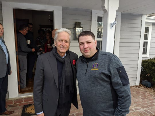 Actor Michael Douglas, who stopped in Oconomowoc to campaign for Democratic presidential candidate Mike Bloomberg, poses with Oconomowoc resident John Zapfel.