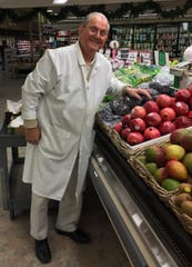 Salvatore Sendik poses for a picture in the produce section of Sendik's/Piggly Wiggly, 2315 N. 124th St. in Brookfield. Sendik, 82 here, visited the store twice a day to chat with customers and check on the fruits and vegetables.
