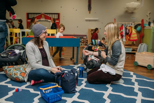 Moms talk to each other while their kids play at Little Sprouts Play Cafe in Shorewood in 2017. The coronavirus stay-at-home order has made things tough for play group facilities.