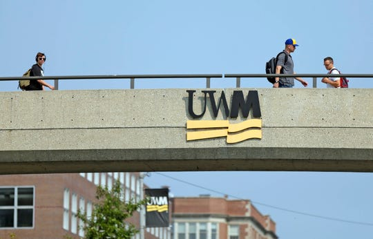 University of Wisconsin-Milwaukee students walk to classes in this file photo.