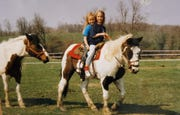 "Andrea Boehlke spent much of her childhood on a horse on her family farm in Random Lake. She is seen here in front with her late sister, Jeri. Andrea's mom, Linda, said Jeri's influence had a lot to do with her family applying for ""Survivor."""