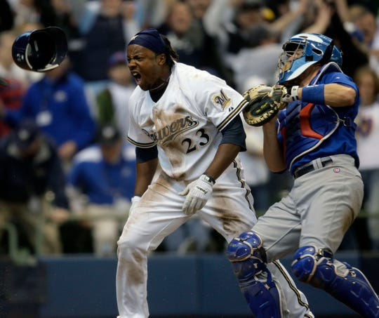 Milwaukee Brewers' Rickie Weeks celebrates after scoring the winning run in the 9th inning against the Chicago Cubs at Miller Park Friday, April 10, 2009.