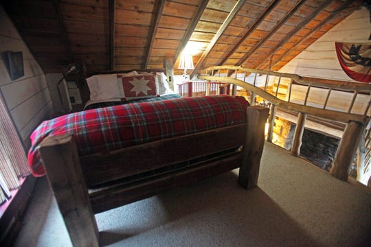The queen bed in the loft bedroom of the Cothren House cabin was made by a local carpenter in the early 2000s.