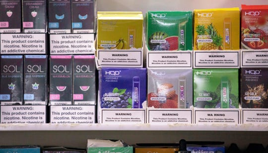 This Jan. 31, 2020 photo shows various brands and flavors of disposable vape devices at a store in the Brooklyn borough of New York.