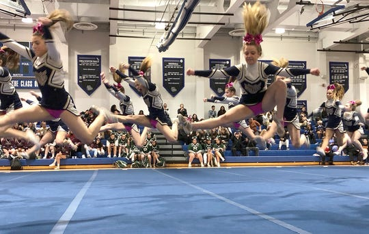 Old Tappan cheerleaders leap into the air during their routine at the Big North Championships on Feb. 7, 2020 at Passaic Tech.