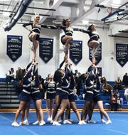 Hackensack performs a stunt during the Big North Championships on Feb. 7, 2020 at Passaic Tech.