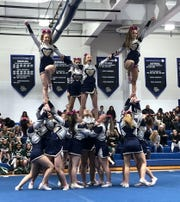 Old Tappan performs a stunt during the Big North Championships on Feb. 7, 2020 at Passaic Tech.