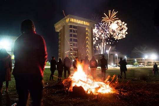 AUM students and fans enjoy a bonfire and fireworks during homecoming week.  AUM will hold a homecoming dinner and dance the night of Feb. 28, culminating a week of activities.