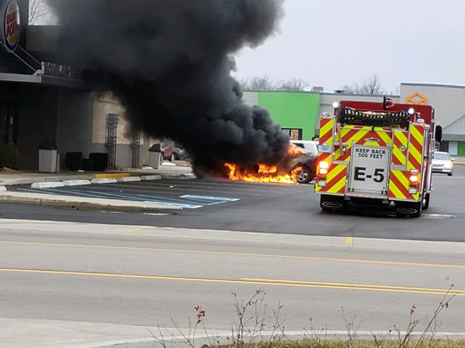 A fire truck arrives at a car fire outside the northwest Muncie Burger King on Bethel Avenue Monday afternoon, Feb. 10, 2020.