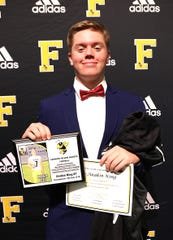 Fairview Senior Anakin King - #7, QB/LB - was presented with awards for MVP-Offense, Team Captain, 4 Time TSSAA Region 6 AAA Champions, TSSAA Region 6AAA All-Academic Team - 2018 / 2019, and 2019 TSSAA Region 6AAA Quarterback of the Year at the Annual Fairview High Football Awards Banquet held on Jan. 10, 2020.
