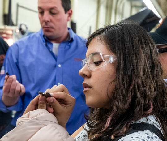 Clarissa Frisby, a student at Desert View High School, inspects a form insert during a tour of Peterson Tool Company on Feb. 10, 2020.